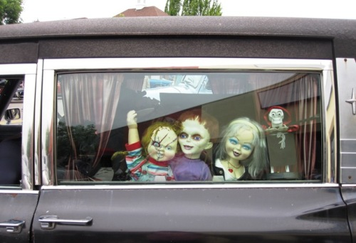 hearse with scary dolls