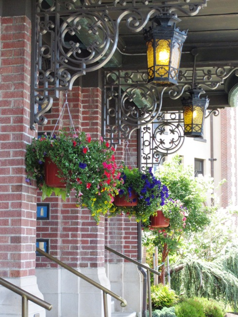 ornamental iron work with hanging baskets